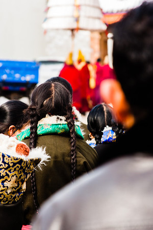 Tibetans silently watch as the Living Buddha and his processional leaves the main courtyard.