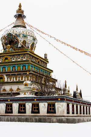 Chortens, like this one at Rongwo Monastery, often contain Buddhist relics or commemorate the site of a holy event. But it is rare to be able to climb to the top of a chorten like you can at Rongwo's chorten.