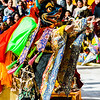 The dancer portraying Yama sprinkles a barley offering before retrieving a weapon to destroy the evil spirits.