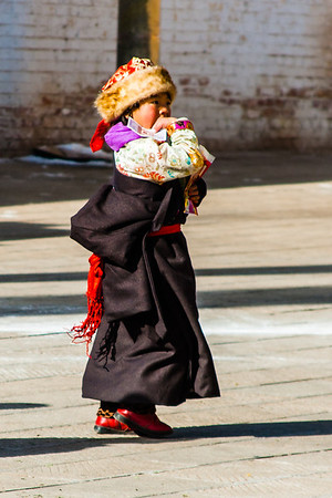 A Tibetan girl in her beautiful new Losar clothes.