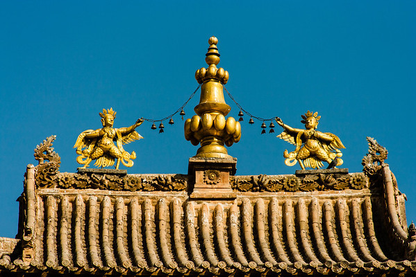 Human-faced garuda adorn the roof of this monastery temple.