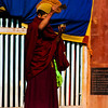 A Yellow Hat Sect monk sprinkling a libation offering before the Cham dance at Rongwo Monastery.