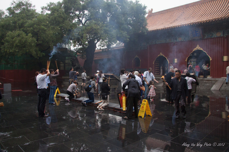 China-1735<br /> Praying and burning incense at the Yonghe Temple. Morning is a popular time for people to stop and pray.