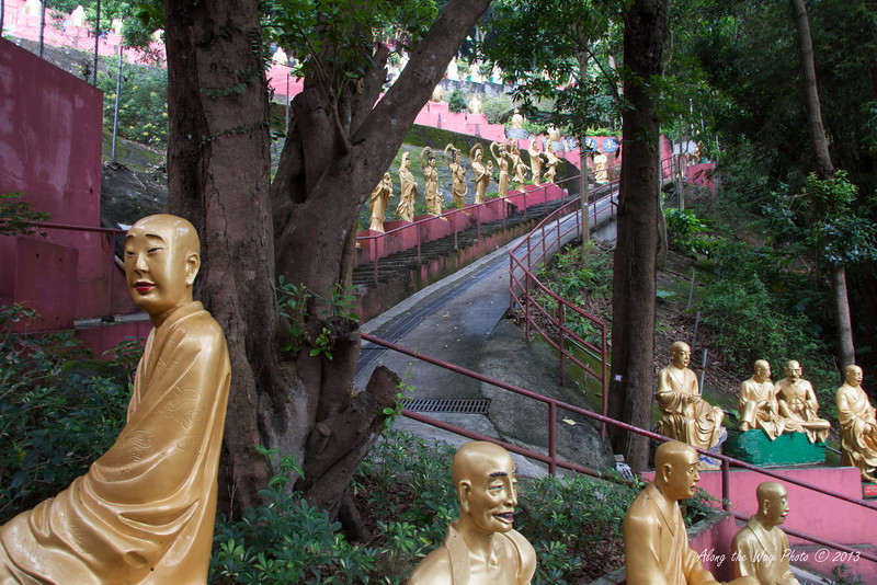 China-4091<br /> To get to the Temples of the Ten Thousand Buddha's you have 430 steps you have to go up.  Life size Buddha's  line the stairs as you climb up to the complex in Sha Tin, Hong Kong. Each statute is different.
