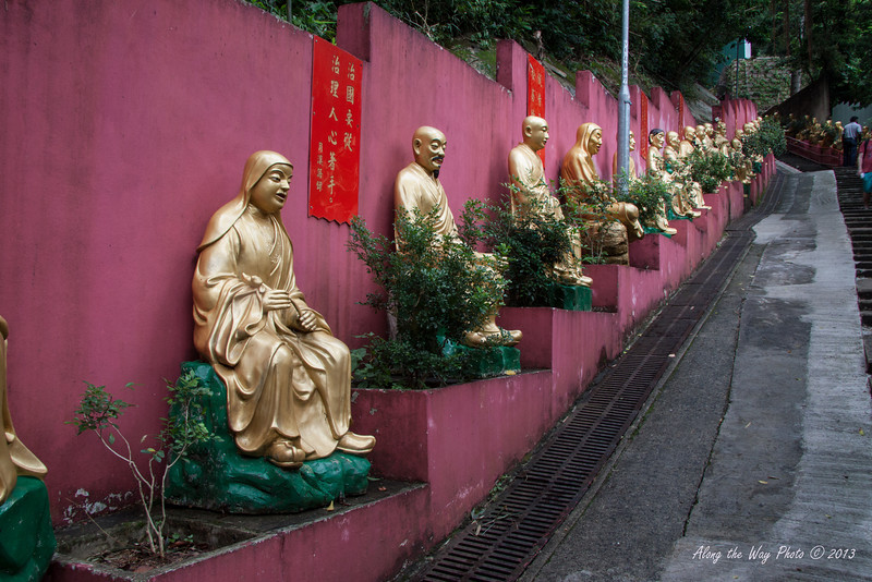 China-4088<br /> To get to the Temples of the Ten Thousand Buddha's you have 430 steps you have to go up.  Life size Buddha's  line the stairs as you climb up to the complex in Sha Tin, Hong Kong.<br /> Each statute is different.