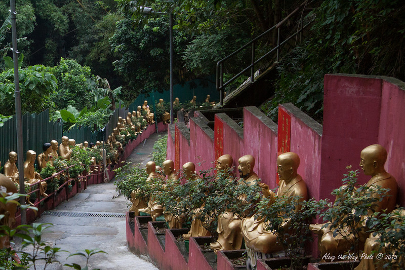 China-4131<br /> To get to the Temples of the Ten Thousand Buddha's you have 430 steps you have to go up.  Life size Buddha's  line the stairs as you climb up to the complex in Sha Tin, Hong Kong. Each statute is different.