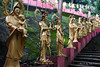 China-4049<br /> To get to the Ten Thousand Buddha's monastery, you have 430 steps you have to go up.  Life size Buddha's  line the stairs as you climb up to the complex in Sha Tin, Hong Kong. Each statute is different.
