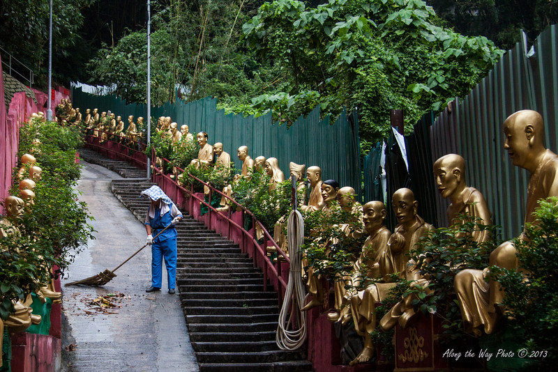 China-4083<br /> To get to the Temples of the Ten Thousand Buddha's you have 430 steps you have to go up.  Life size Buddha's  line the stairs as you climb up to the complex in Sha Tin, Hong Kong. Each statute is different.