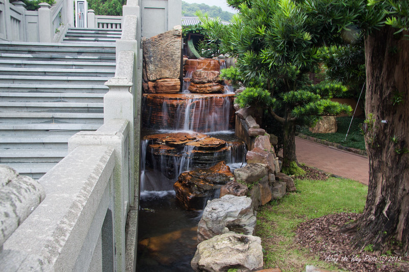 China-001-3<br /> Bridge with waterfall in the Nan Lian Gardens in the Chi Lin Nunnery Complex in Kowloon, Hong Kong.