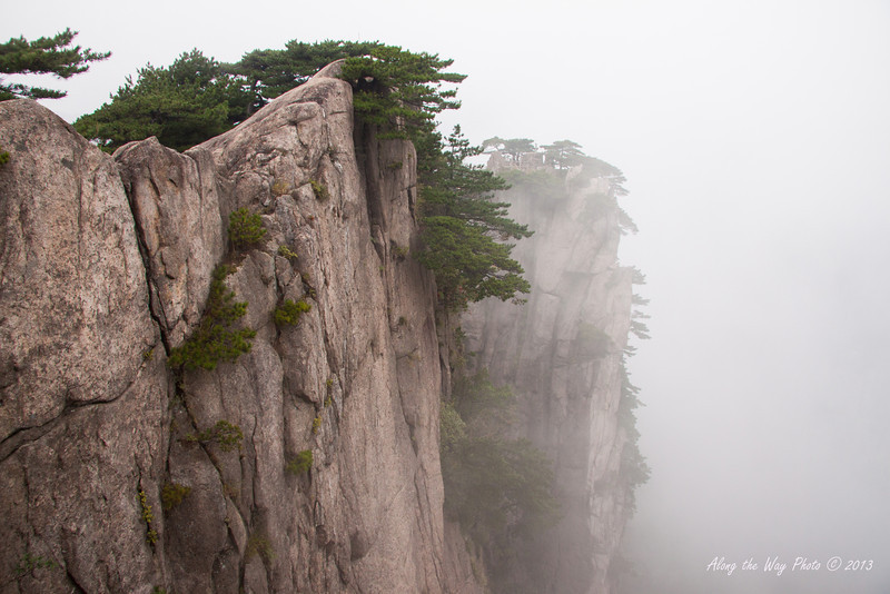 China-3703<br /> Huangshan Mountain range is in Eastern China. Mountain peaks will reach 3250 feet with clouds below the peaks more then 200 days a year. Huangshan is Yellow in mandarin, so the Mountains are commonly referred to as the Yellow Mountains.