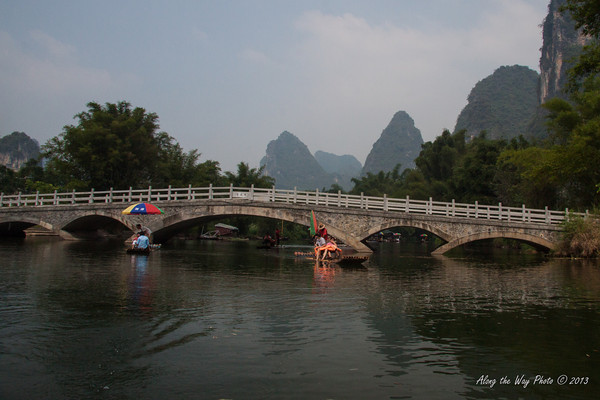 China-2409<br /> Yulong Bridge, a 400 year old bridge with typical arch style Chinese bridge on the Yulong River.