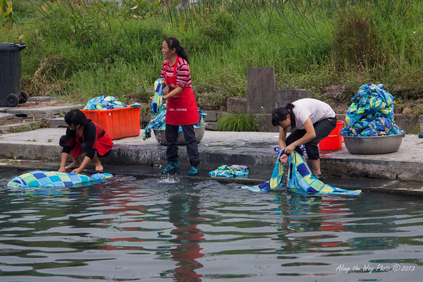 China-3552<br /> Women doing laundry in a pond in Xidi Village.
