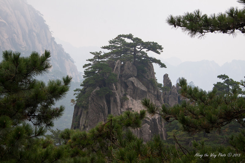 China-3685<br /> Huangshan Mountain range is in Eastern China. Mountain peaks will reach 3250 feet with clouds below the peaks more then 200 days a year. Huangshan is Yellow in mandarin, so the Mountains are commonly referred to as the Yellow Mountains..