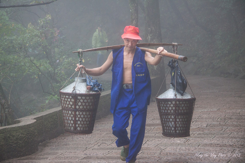 China-3771<br /> Porters carry everything up to the hotels and any material needed for the fences or sidewalks. What supplies are needed on top of the mountain needs to be brought up by the porters. They will carry 100 to 120 lbs.