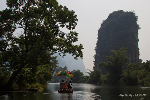 China-2356<br /> Rafting down the Yulong River with views of the Mountain Rocks on both sides of the river. The Mountain Rocks are Karst formations, Limestone that has been weathered and eroded over time.
