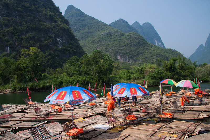 China-2259<br /> Bamboo Rafts on the Yulong River, also known as the Dragon River. Yulong is a tributary of the Li River.