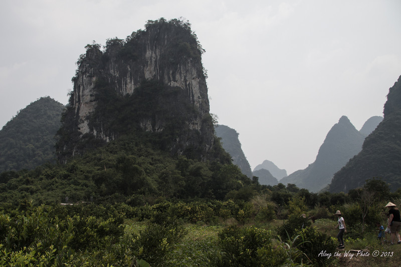China-2421<br /> Small farming village off the Yulong River amongst the Mountain Rocks. These are Karst formations, Limestone that has been weathered and eroded.