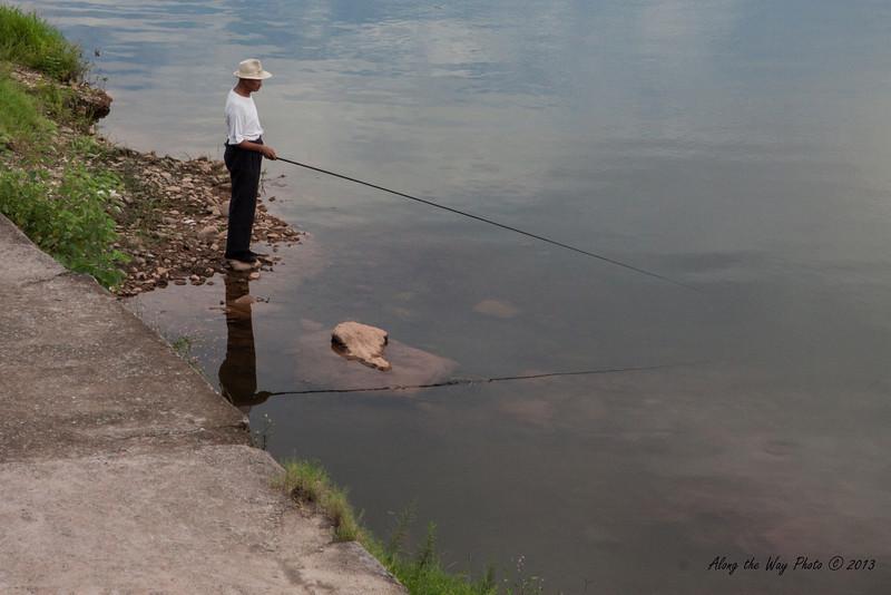 China-3361<br /> Fisherman in Tunxi, China.