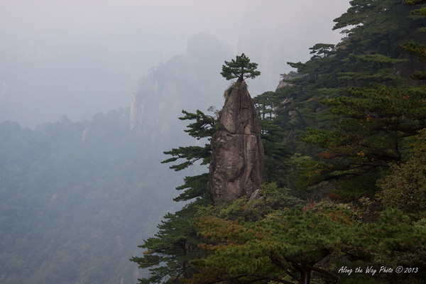 China-3710<br /> Huangshan Mountain range is in Eastern China. Mountain peaks will reach 3250 feet with clouds below the peaks more then 200 days a year. Huangshan is Yellow in mandarin, so the Mountains are commonly referred to as the Yellow Mountains.