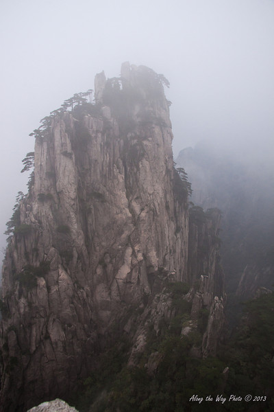China-3699<br /> Huangshan Mountain range is in Eastern China. Mountain peaks will reach 3250 feet with clouds below the peaks more then 200 days a year. Huangshan is Yellow in mandarin, so the Mountains are commonly referred to as the Yellow Mountains.
