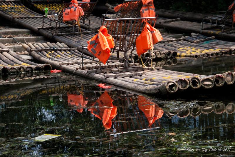 China-2282<br /> Bamboo rafts reflecting in the Yulong River.