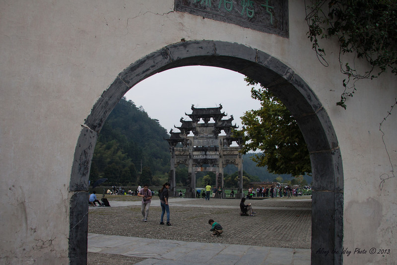 China-3543<br /> The old entrance gate to Xidi Village, framed in doorway.