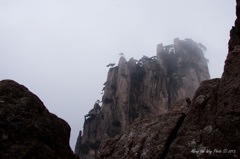 China-3694<br /> Huangshan Mountain range is in Eastern China. Mountain peaks will reach 3250 feet with clouds below the peaks more then 200 days a year. Huangshan is Yellow in mandarin, so the Mountains are commonly referred to as the Yellow Mountains.