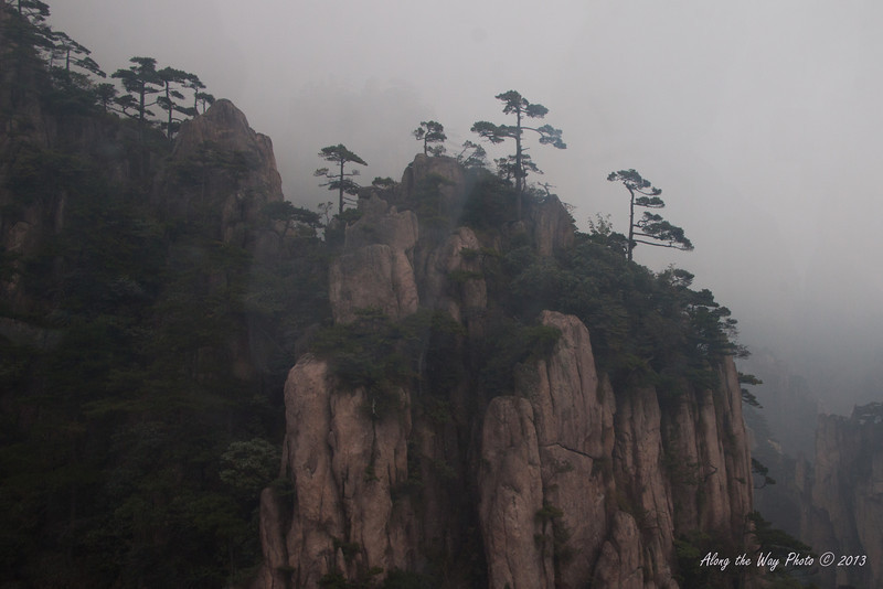 China-3663<br /> Huangshan Mountain range is in Eastern China. Mountain peaks will reach 3250 feet with clouds below the peaks more then 200 days a year. Huangshan is Yellow in mandarin, so the Mountains are commonly referred to as the Yellow Mountains.