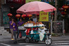 China-3330<br /> Street vender in Tunxi has her fruit stand on the back of her three wheel motorcycle.