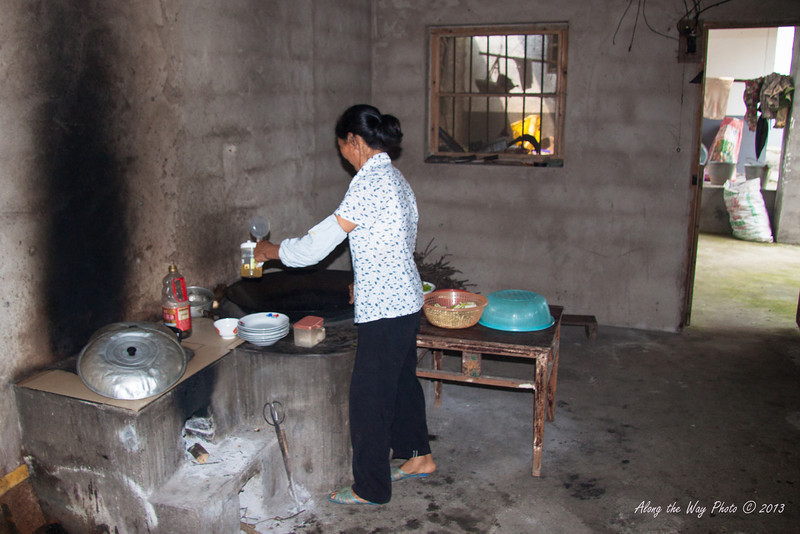 China-2455<br /> Kitchen in a farm family's home off the Yulong River.