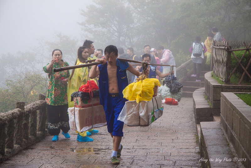 China-3784<br /> Porters carry everything up to the hotels and any material needed for the fences or sidewalks. What supplies are needed on top of the mountain needs to be brought up by the porters. They will carry 100 to 120 lbs.