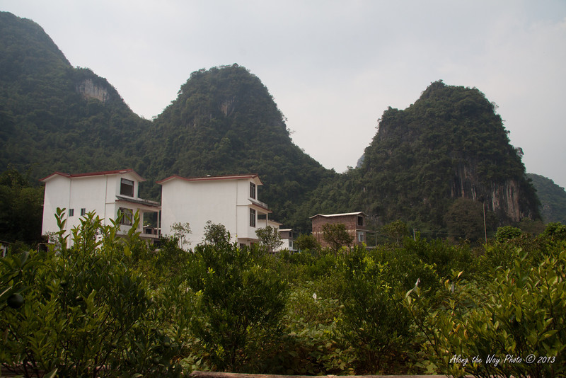 China-2557<br /> Small Farming village off the Yulong River amongst the mountain Rocks.