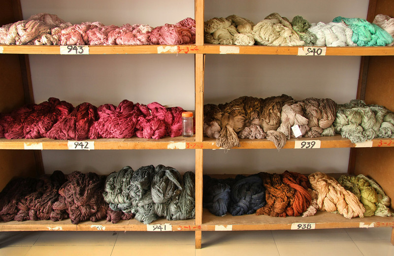 Skeins of dyed silk thread in various colors at a silk rug factory in Shanghai, China.