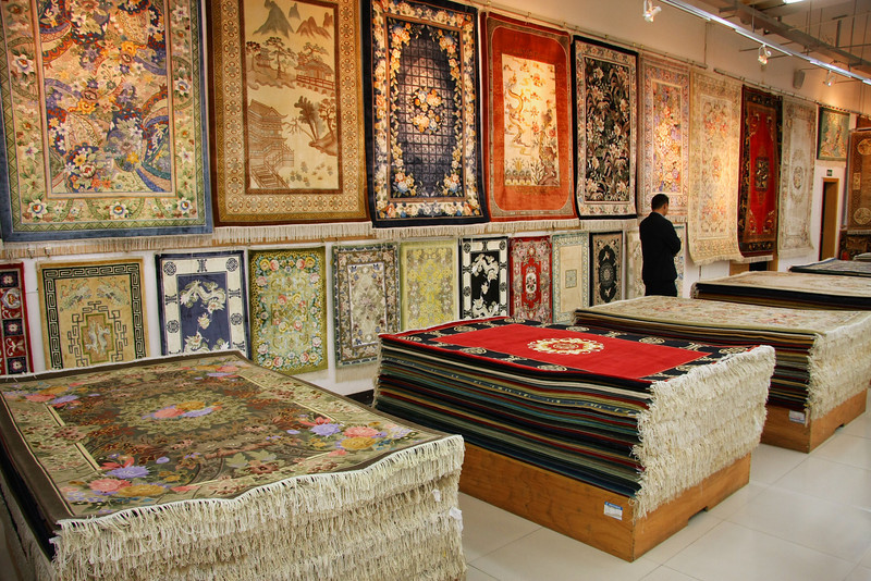 Silk rugs on display and for sale in Shanghai, China (salesman is not recognizable).