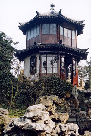 A pagoda overlooking a Chinese garden beckons weary visitors with open doors.