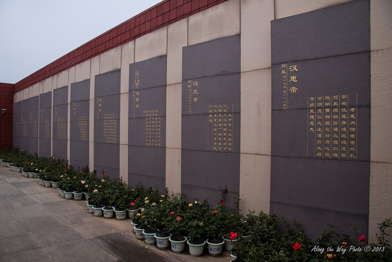 China-2205<br /> Wall with the emperors of the Han Dynasty listed. You go by the wall as your going to the entrance of the underground museum.