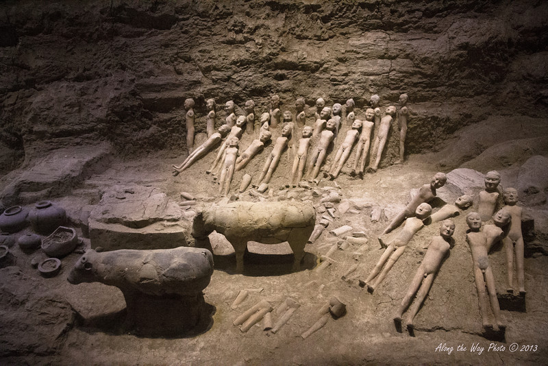 China-2225<br /> Many of the figurines found did not have arms or clothes when they were uncovered. It is believed the arms were wood and over the centuries the clothing and arms deteriorated. Yangling Mausoleum museum in Xian.