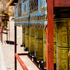 Prayer wheels line the kora path around Namtso.