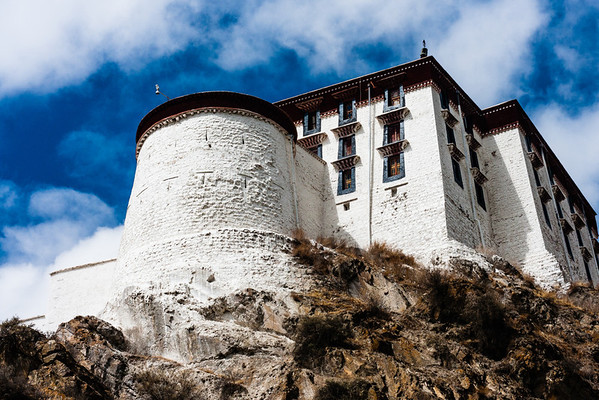 Potala Palace rises above the kora path.
