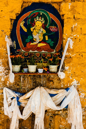 An altar built into the wall along the kora path around Potala Palace.