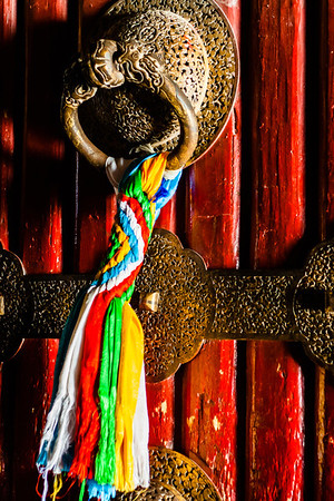 Tassels hang from a door knocker in Potala Palace.