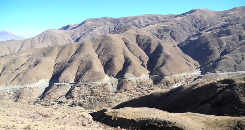Leaving the Lhasa River valley, we climb up this twisty snake to 15,000 ft to pass over to Lamdrok Lake