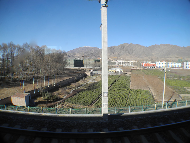 "Sorry about the post - sometimes difficult to get pix from a moving vehicle. We are now on the ""Qinghai Express"" to Lhasa, Tibet"