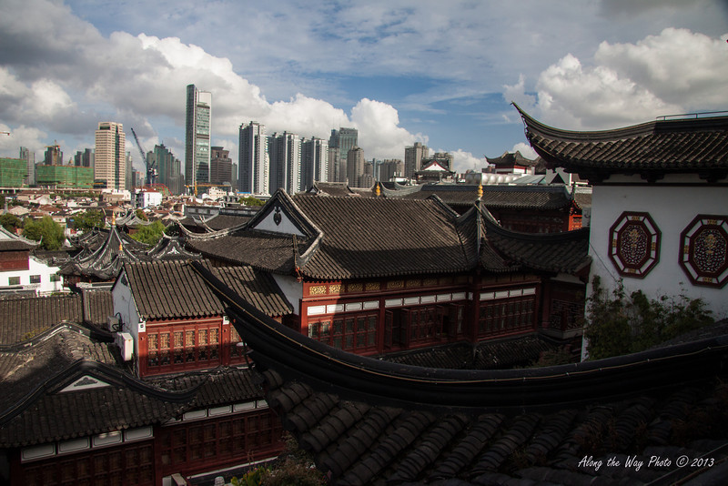 China-3008<br /> Looking out over the roofs of the Yu Yuan Bazaar with the new Shanghai in the background. Old Shanghai in the middle of the new Shanghai.