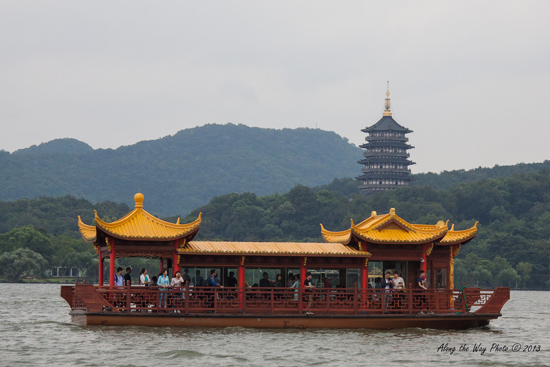 China-002-16<br /> Boat on West Lake with Lei Feng Pagoda in background in Hangzhou, China.