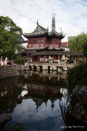 China-2970<br /> Small lake in the Yu Yuan Gardens in Shanghai, China, Is part of the Old town of Shanghai. Also includes the Yu Yuan Bazaar. Gardens were founded in the mid 1500's.