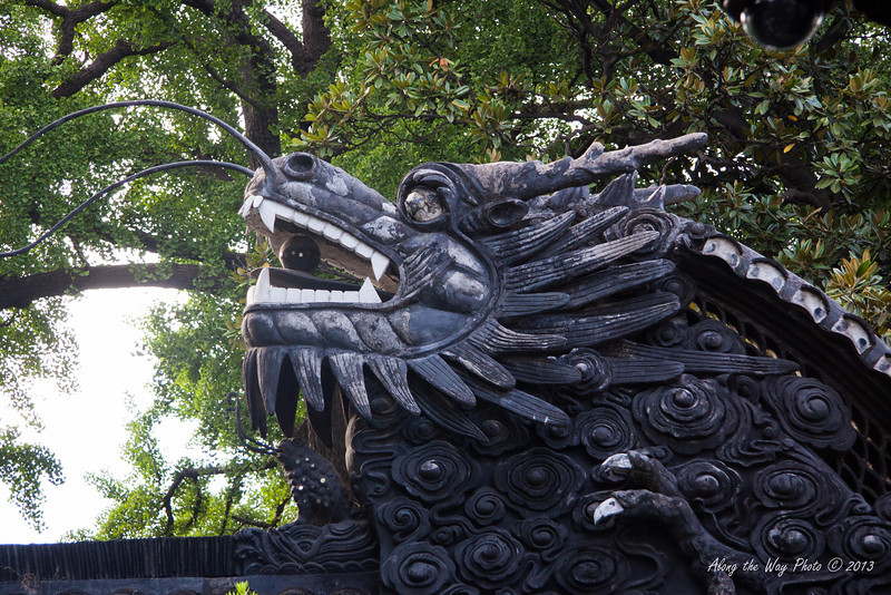 China-2988<br /> Sculpture on Gate going into the Yu Yuan Bazaar from the Gardens in shanghai, China. Is part of the Old town of Shanghai. Also includes the Yu Yuan Bazaar. Gardens were founded in the mid 1500's.
