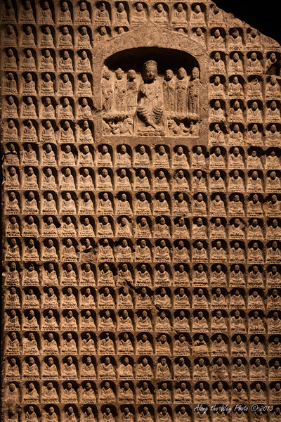 China-2844<br /> Ancient Chinese Sculpture Gallery, in the Shanghai Museum, has a hundred pieces on display from the warring states period through the Lio and Jin dynasties. This is the Thousand-Buddha Stele dated between 557 to 581.