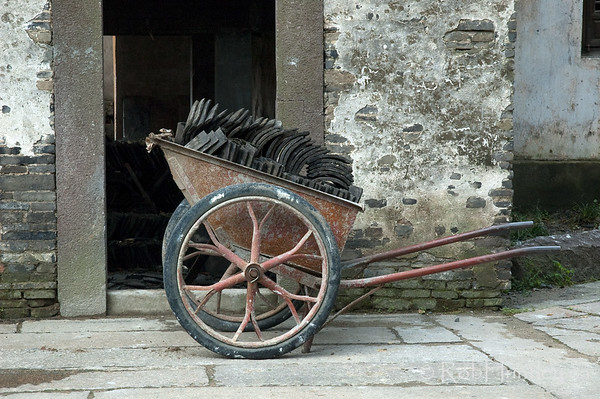 Roofer's Wheelbarrow. Wheelbarrow with roofing tiles in Wuzhen, China. © Rob Huntley
