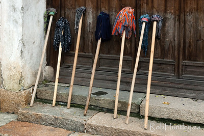 Choose your weapon - selection of mops leaning against a building wall in Wuzhen, China. © Rob Huntley